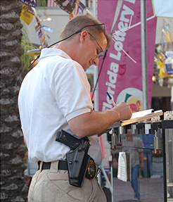 Florida Lottery Security Officer taking a report